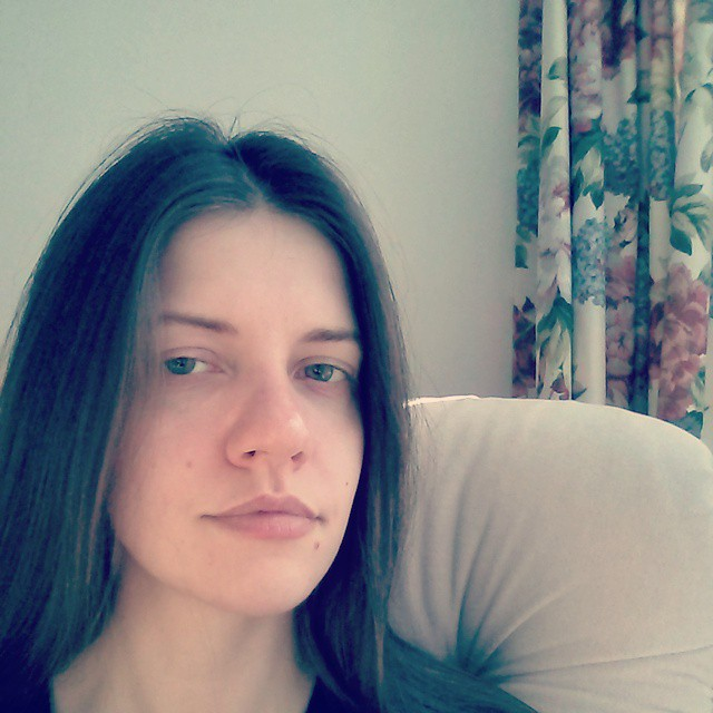 a photo of laurel green without makeup