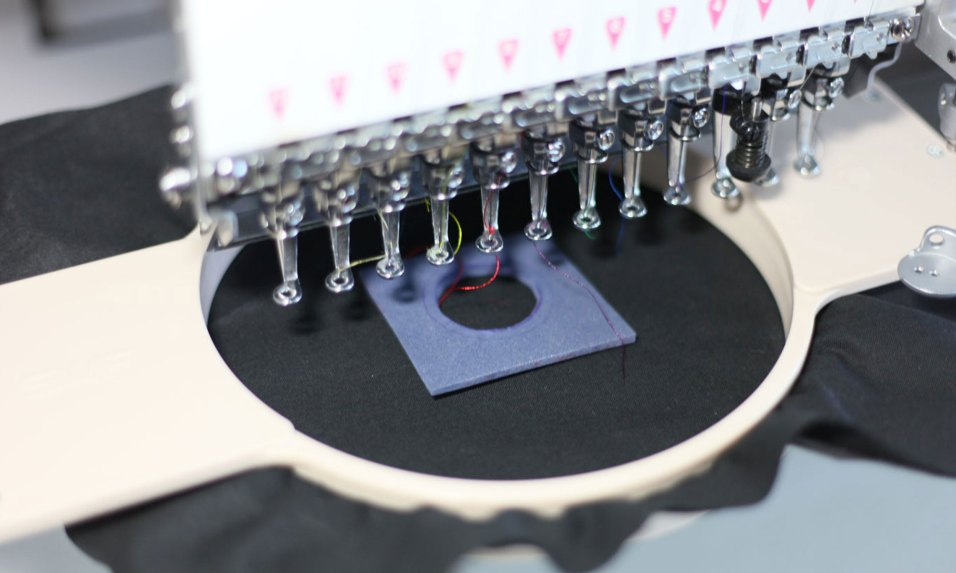 Cut a hole in the filler material big enough to fit the pressure sensor. Embroider an edge to fix the filler position and attach it to the fabric.