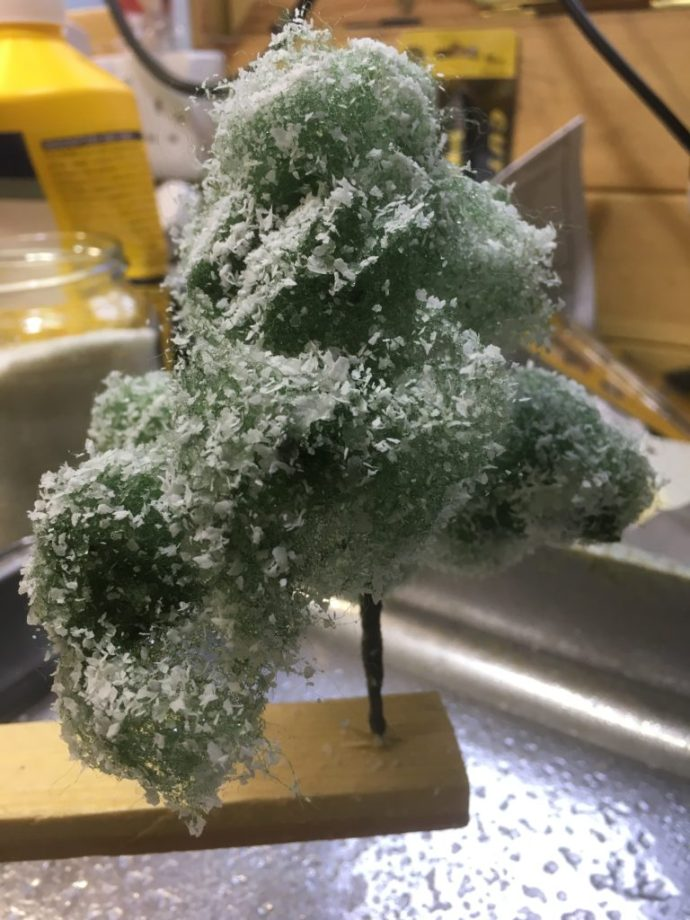 Wetted tree coated with Polycell powder