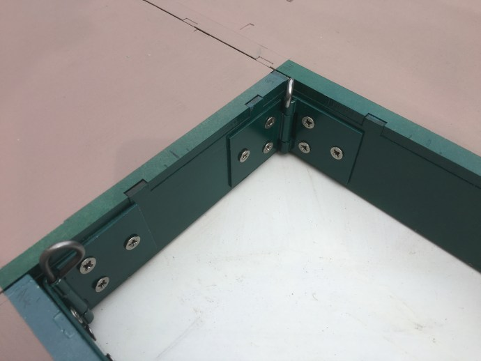 Removable pin split hinges linking baseboards