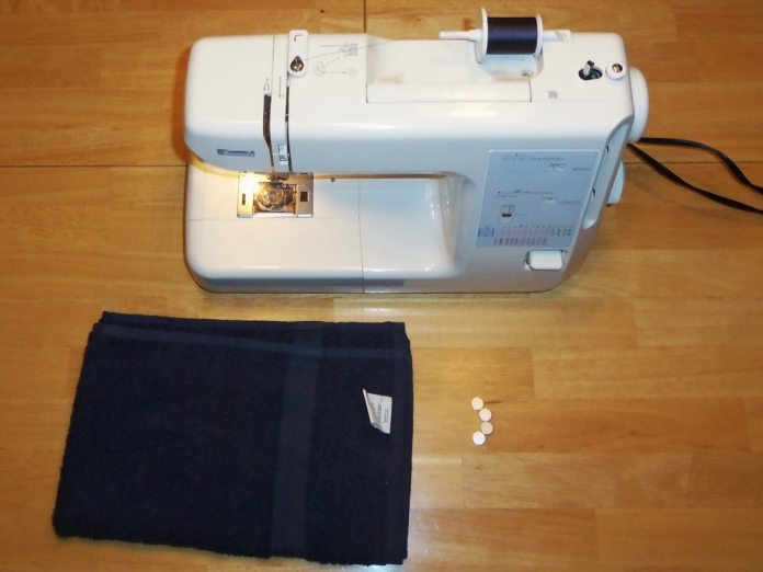 All you need to make a magnetic fuel-spill towel is a hand towel, some magnets and a sewing machine. Oh, yeah, it helps to know how to sew. If you don't have the skills, then beg your spouse to help with the racecar.