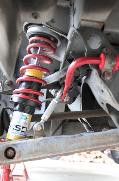 Stiffer bushings reduce the magnitude of bump steer. If the rules of your class allow for it, replacing the bushings with spherical bearings further reduce it to near zero.