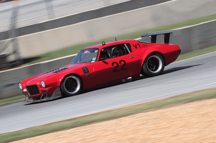 One of the fastest cars on track is Joe Freda's Outlaw Vintage Camaro, which had a significant tire rub in Turn 1 in one of Saturday's morning sessions.