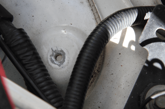 Find a good grounding spot, such as this threaded hole and scrape off the paint so you are getting metal-to-metal contact.