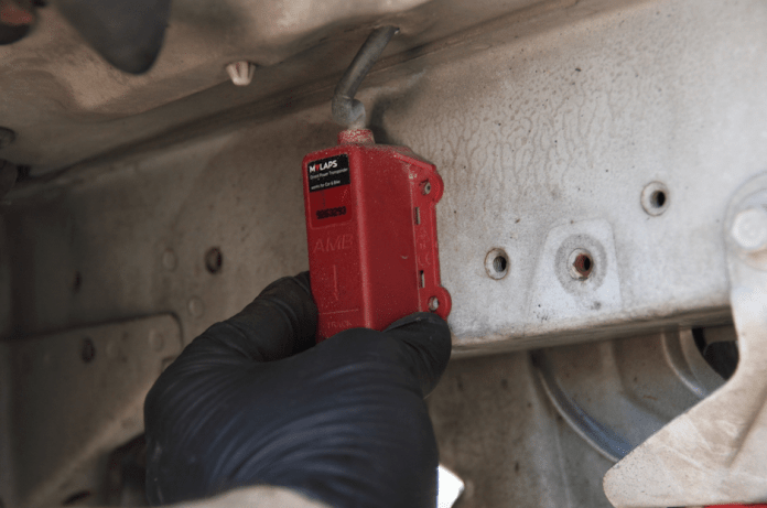 Find a location that allows you to mount the AMB transponder vertically, with a clear shot at the track surface and away from heat that exceeds 122 degrees Fahrenheit. AMB even put an arrow on the unit to make it easy. Mark your holes with a Sharpie, punch dimples and start drilling.