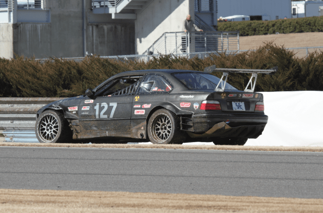 Turn 4 apexes at the crest of a blind hill, and it sent one BMW spinning off track.
