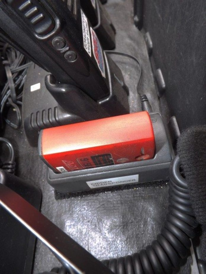 Inside our toolbox charging station, we plug our transponder in at night to get a fresh charge before a race weekend. The number of blinking green lights in succession indicates how many days are left on the transponder charge.
