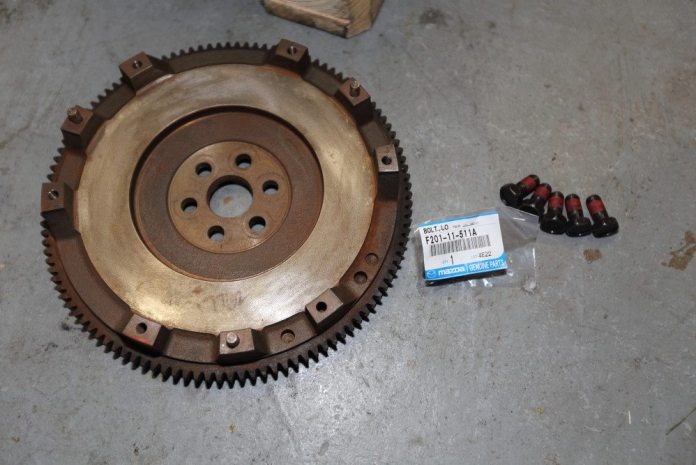 Because Mazda makes it so easy to get replacement parts, we opted for new flywheel bolts, which come pretreated with a thread-locking compound. Despite its looks, the flywheel had been resurfaced, but it had been sitting in the garage for a while. The rust will come off the friction surface the first time you engage the clutch.