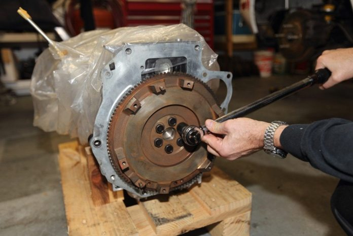 Torque the flywheel bolts to 74 foot-pounds using a decent torque wrench. Torque them diametrically across and around the bolt pattern.