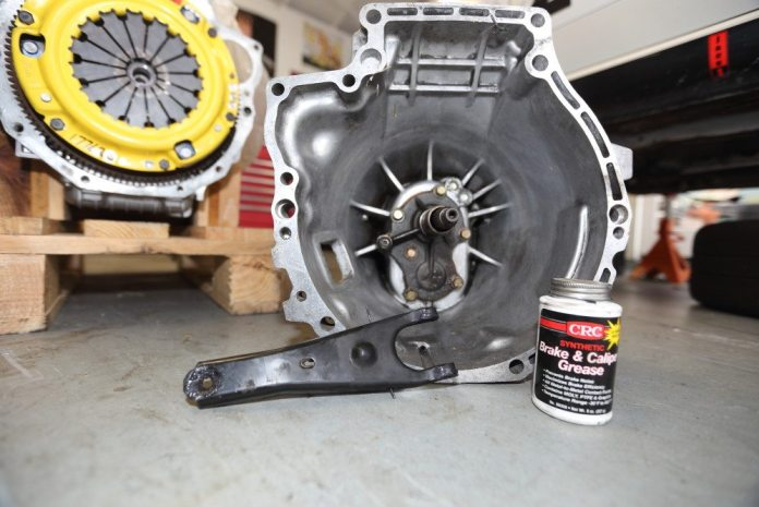 """It's also a good idea to grease the """"tines"""" on the release fork, the saddle on which it pivots and the pocket into which the slave cylinder piston fits. We used brake and caliper grease because of its ability to withstand high temperatures without liquefying."""