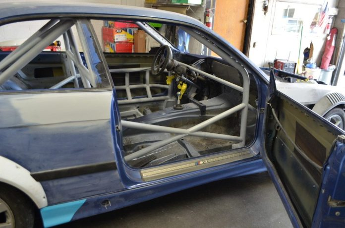 The cage includes NASCAR bars on the driver side and a lateral brace that ties the two sides of cage together.