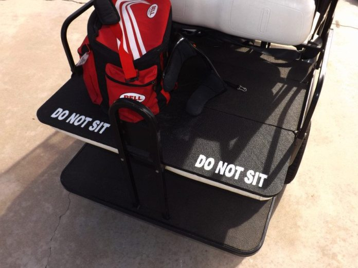 This model golf cart has a flip-down back seat to store gear on. We use this feature quite a bit. The four-seater golf cart is great for getting the crew to the drivers meeting and also can carry tires or fuel cans around the paddock.