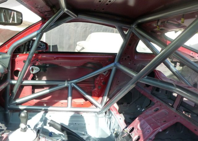 Chassis flex makes the whole car an undamped spring which is very difficult to tune. Well-conceived bar placement should improve the structural integrity of the roll cage and improve safety. A byproduct of this is an increase structural rigidity of the platform, which will reduce chassis flex also.