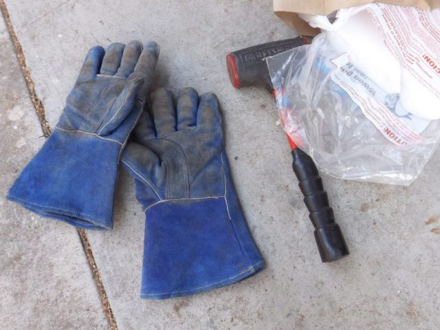 Leather welding gloves, a hammer and dry ice is all you need to get rid of the sound-deadening material. The gloves are the most important tool for safety. Dry ice will burn you, just like regular heat can burn you. Do not make direct contact with the skin.