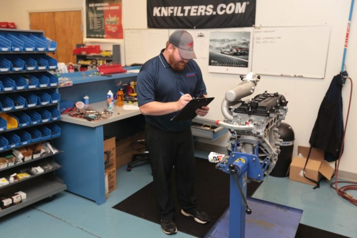 Élan engine builder Todd Therkildsen gets an engine ready to take to the assembly room where it gets mated to the transaxle and installed in the chassis.