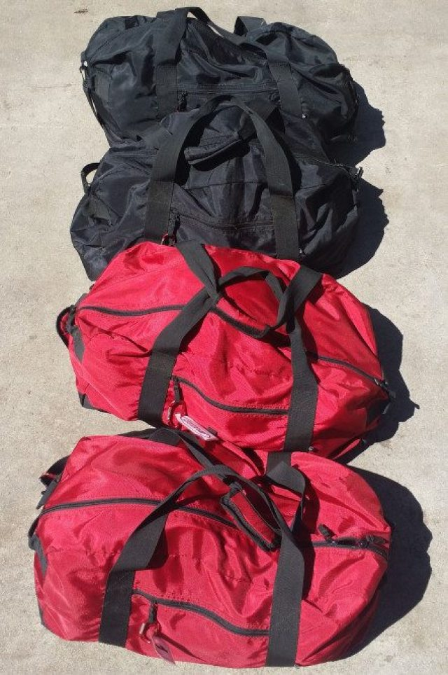 Keeping track of helmets, socks, suits, gloves and underwear can be a nightmare. We purchased some inexpensive duffle bags to help us store, organize, and travel with the pit crew's gear. Each bag contains all of the required gear for one volunteer crew member.