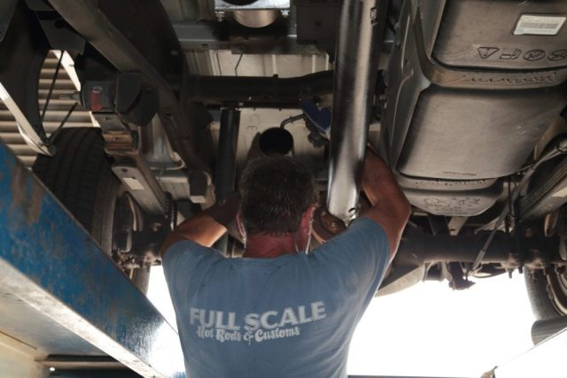 With the front pipes hung and bolted in place, Martin hangs the pipe that goes over the rear axle.