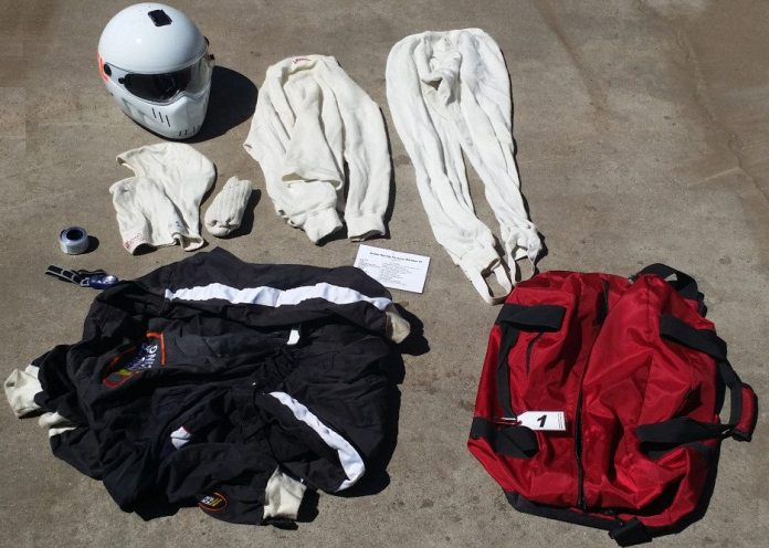 Each crew bag has a helmet with a clear face shield, a single-layer fire retardant suit, upper and lower Nomex underwear, a pair of Nomex socks, fire retardant gloves, a balaclava, racing shoes, knee pads, a head strap LED flashlight, reflective straps, and the most important item: an inventory list to encourage crew members to put all gear back into the assigned bag.