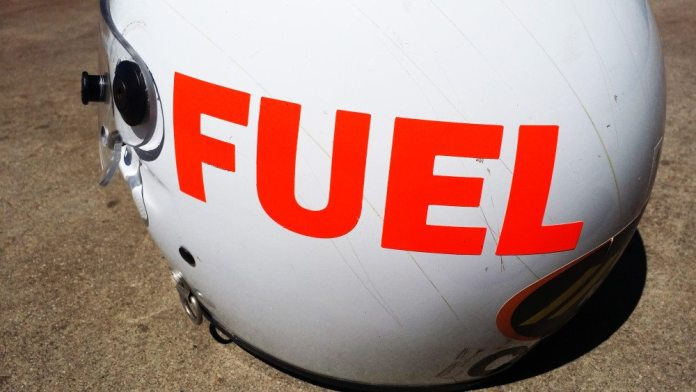 "NASA allows crew members to use expired helmets. However the requirement is that the helmet be clearly marked with the word ""FUEL"" as to distinguish an expired helmet from a current one. If a NASA official ever sees an HPDE driver heading out onto the track with a big orange ""FUEL"" on the side of his helmet, I can guarantee you that driver will be on a very short session. Each of our crew helmets uses a clear face shield and has a GoPro mount for pit-stop-filming opportunities."