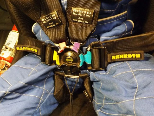 Here is the whole system put together with all of the colors matching. The person putting on the belts should be able to quickly see everything is in the right place with all of the colors showing. If one belt isn't showing colored tape then the belt is twisted which could be dangerous for the driver and difficult to tighten or loosen that particular strap.