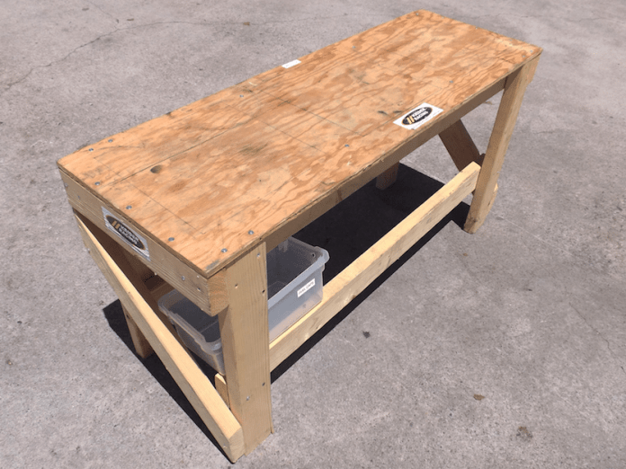 This simple table design was constructed of 2x4s, a piece of 1/2 inch plywood and wood screws. The cross bracing attached to the sides increases stability for the table. The height of the table was designed to be the same elevation of most race track pit walls, which is 24 inches.