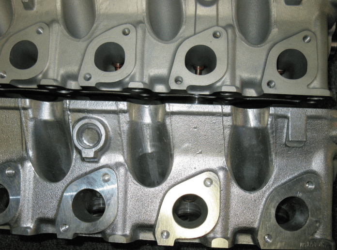 The exhaust ports are largely the same on the OEM head (top) and the aftermarket AMC head.