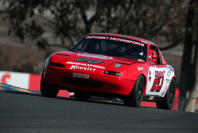 The E3 class was won by this red-and-white Mazda Miata driven by Bruce Pendleton after he fought off two hungry BMW E30s.