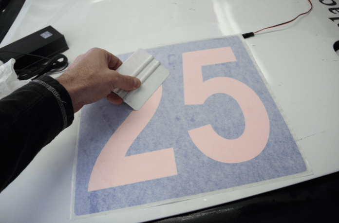 "By using reverse cut numbers, you cover most of the pink with whatever color vinyl you choose. This is as close to ""Mazda blue"" as I could find. Apply decals with a sprayer filled with water and a couple of drops of baby shampoo, which lets the decal stick better than Windex, then squeegee out the air and liquid."