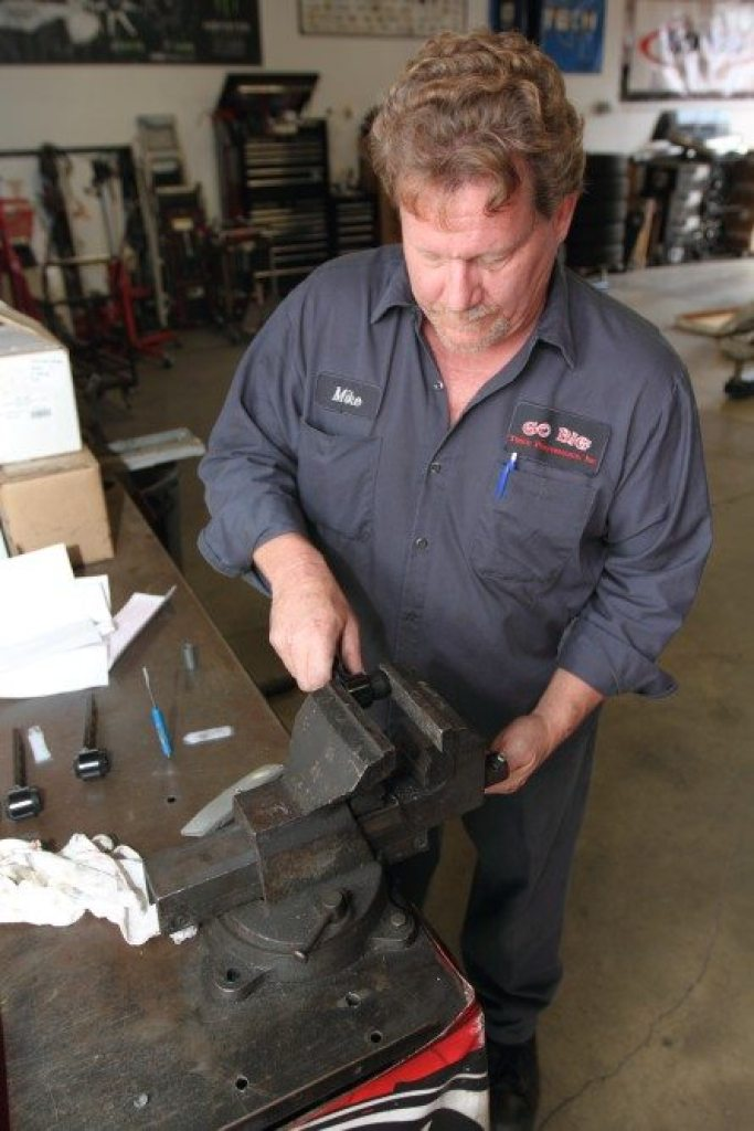 The bushings don't come installed in the end links. They press in easily with the supplied grease and a vise.