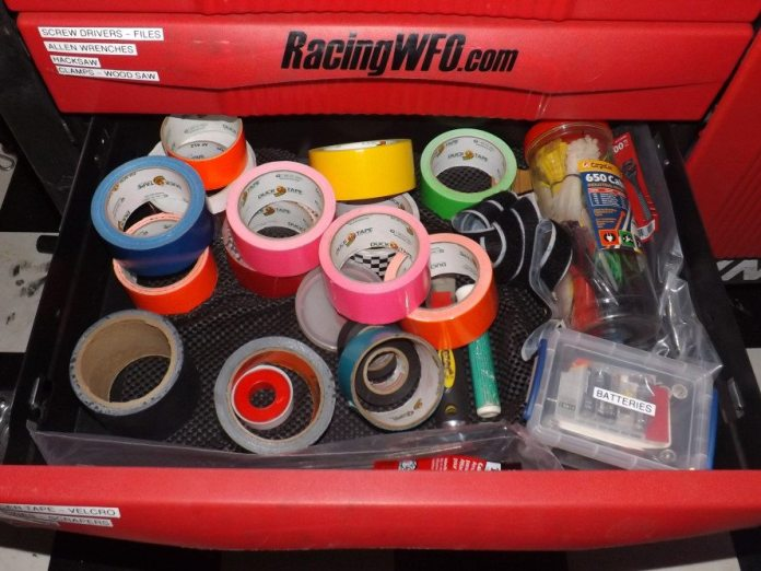 This is our tape drawer in our toolbox filled with lots of neon colored tape from Walmart. We use this stuff for everything, color coding seatbelts, making connections easier to see at night (like helmet radio wires) and marking the pit wall where all of tools and people should be ready for a pit stop. The stuff is cheap and very effective.