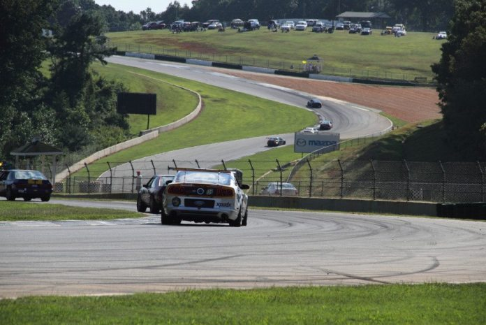 Hug the Turn 4 apex curbing. This turn's apex is a great place to use momentum to overtake and slingshot past a slower or unsuspecting car as you enter the top of the Esses.