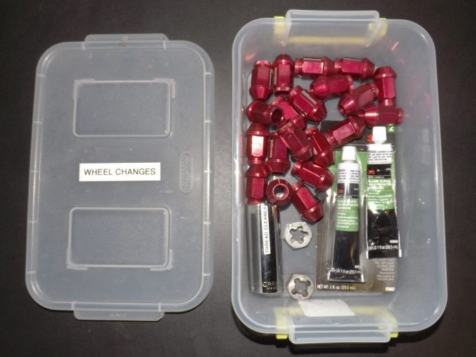 We keep our wheel-change gear in a tidy little box to stay organized in the chaos of the pits. Everything we need for a wheel swap is in this box: extra lug nuts, 3M adhesive, thread cleaners, the specific-size socket for the thread cleaners, etc. We also keep an extra six-point socket available in case something goes awry with a stop, like a lug nut getting stuck inside the socket.