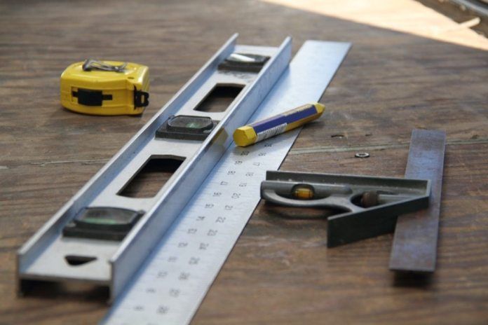 You will need a tape measure for measuring the floor plan of the trailer, a crayon for marking the matting, straight edges and a combination square for making straight and 90-degree lines and cuts. You'll also need a nice sharp utility knife and knee pads if you have some. Definitely knee pads if you're over 40.
