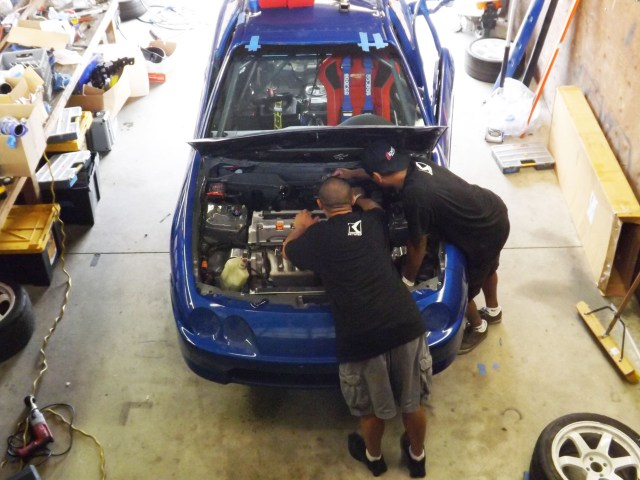 This was the scene in garage 2 most of the week at the NASA Championships: the blue Acura slowing coming together.
