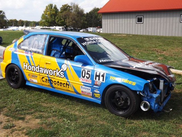 Helms' Honda Civic, which was fast in practice, sustained too much damage to repair after a loose oil line caused him to hit a tire barrier and a guardrail.