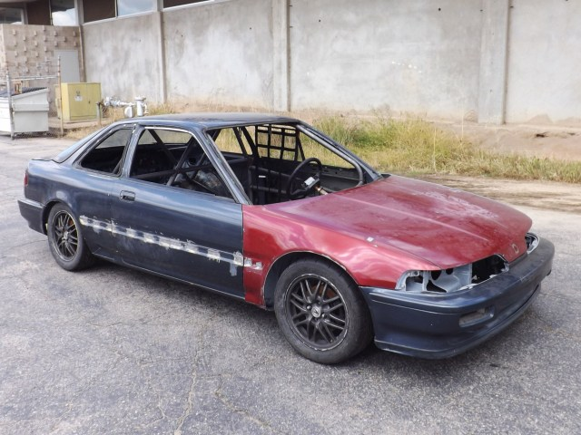 Here is our Honda Challenge project car. It has some fresh sheet metal thanks to the local Pick-Your-Part. Now it has a roll cage thanks to the hard work of the folks at Autopower in San Diego. All that is left to do is darn near everything.
