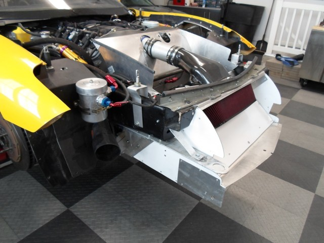 A skilled fabricator, Smith built an air intake for the radiator, and mounted it at the bottom of the front bumper fascia, above the splitter.