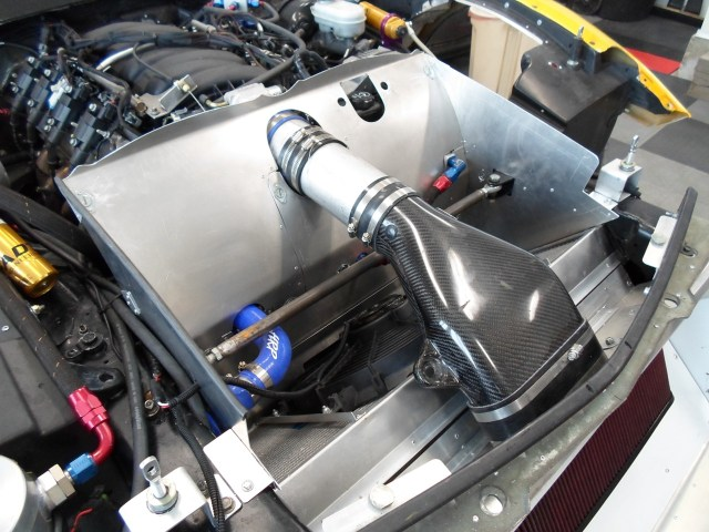 Smith fabricated the chimney so he could install and remove it without having to disconnect any air intake, oil or coolant plumbing. Dzus fasteners hold everything in place.