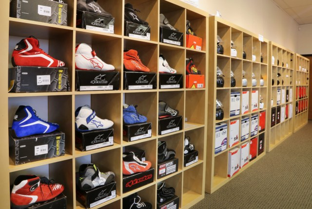 Some 75 percent of the company's sales are online, but Winding Road Racing opened two retail stores, which allow buyers to touch and feel things like helmets, shoes, suits and seats.