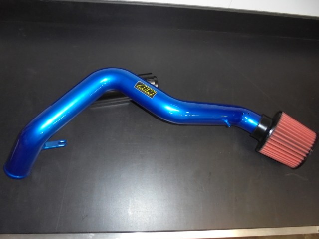 There is some debate among Honda Challenge racers about the perfect length intake tube, but shorter versions pull air from under the hood, which is hot from the engine. This AEM intake tube will provide cold, clean air from the right front fender area of the car.