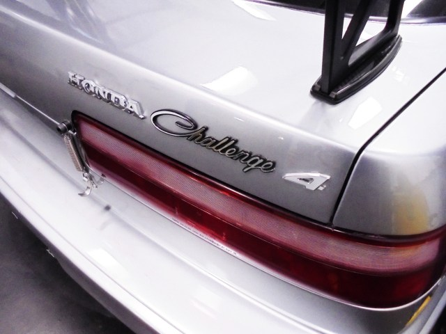 We scored some vehicle emblems on the cheap from Ebay and created this Honda Challenge 4 logo for our rear hatch. We sourced the Honda logo from a Prelude, the Challenge is a Dodge Challenger logo with the R cut off, and the 4 is from a 4WD logo with the WD cut off.