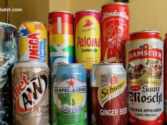 Mehrere Dosen wie Paloma Limonade, Faxe-Bier, Schepps, Punica und andere sind abgebildet.