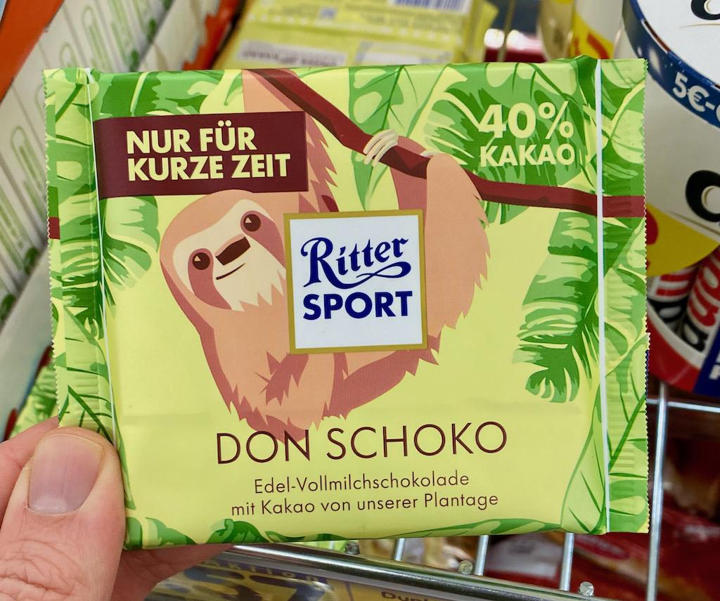 Ritter Sport Don Schoko Edelvollmilchschokolade mit Kakao von der Ritter Sport-PLantage 40% Kakao Faultier-Motiv