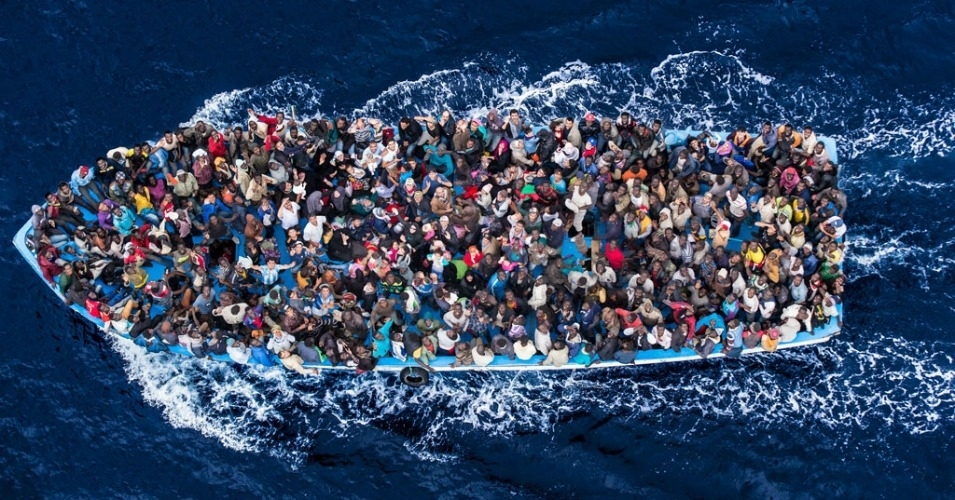 Refugees and migrants on a fishing boat pictured before making contact with the Italian navy. (Photo: Italian Coastguard/Massimo Sestini)