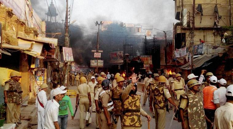 Mainpuri: Police in action after villagers vandalised properties and resorted to arson in Mainpuri district on Friday over rumours of cow slaughter in the area. Photo: PTI