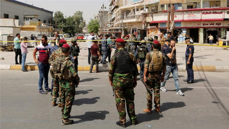 Iraqi security forces gather at the site of the blast [Ahmed Saad/Reuters]