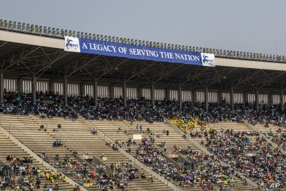 Members of the public sit in the stands during the state funeral for former president Robert Mugabe, at the National Sports Stadium, in the capital Harare, Zimbabwe, Sept. 14, 2019.