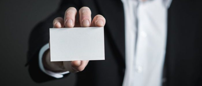 Man holding a white card