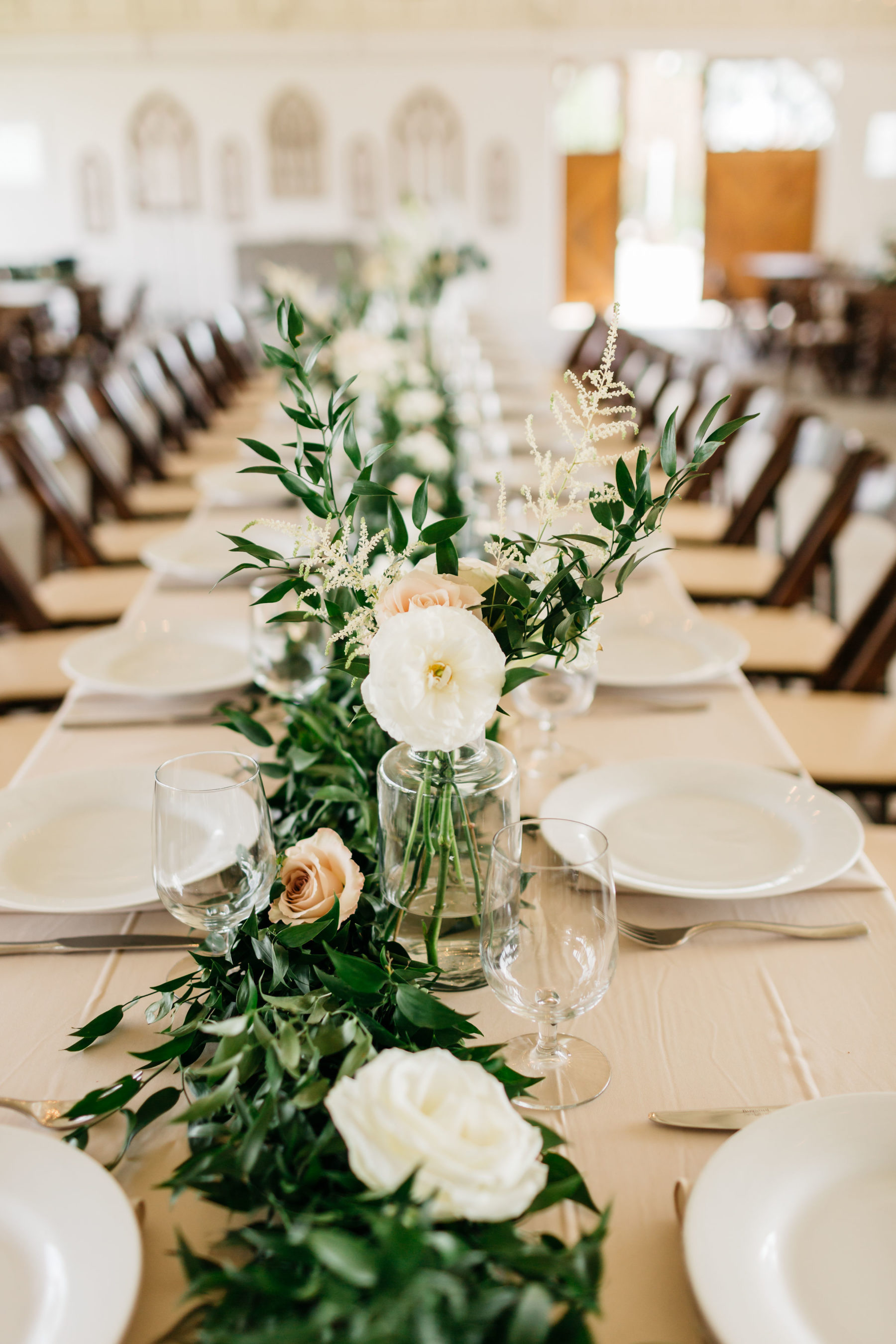 Greenery wedding centerpieces: Rustic Front Porch Farms wedding featured on Nashville Bride Guide