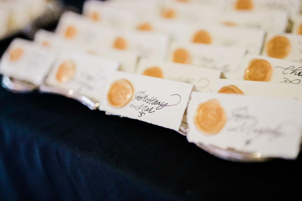 Gold wax seal wedding escort cards for Nashville wedding